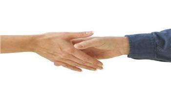 Two people shaking hands for a deal
