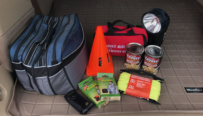 Photo of trunk of car with emergency items in it