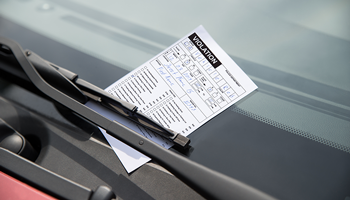 Parking ticket placed on vehicle windshield