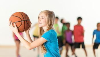 Day Camp image girl playing basketball